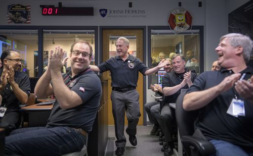 New Horizons principal investigator Alan Stern (centre) of the Southwest Research Institute celebrates the breakthrough with other mission team members.