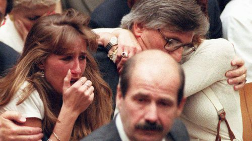 Fred Goldman, father of Ron Goldman, hugs his wife Patti, as his daughter, Kim, left, reacts during the reading of the not guilty verdicts in the O.J. Simpson double-murder trial in Los Angeles in 1995. Simpson was acquitted in the murders of Goldman and Simpson's ex-wife Nicole.