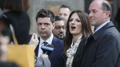 Attorney Donna Rotunno, center, waits to speak to reporters outside a Manhattan courthouse after her client, Harvey Weinstein, was found guilty.