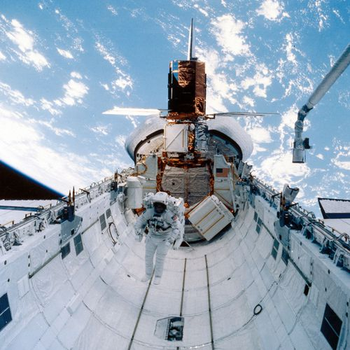 During Space Shuttle Challenger mission 41-C, launched on 6th April 1984, astronauts George Nelson and James van Hoften captured the Solar Maximum Satellite that had failed in orbit four years before, taking it back to Challenger where they repaired and released it again.