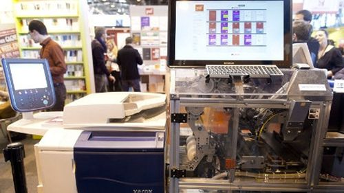 Bound to please: Book-making machines star at French fair