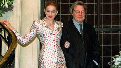 "Actress-singer Madonna arrives for a news conference about the musical film ""Evita"" with British director Alan Parker in Buenos Aires on Feb.6, 1996"