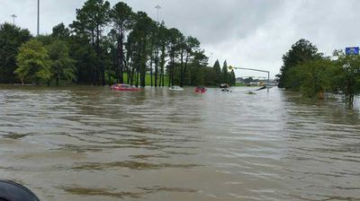 Cars partly submerged in Denham Springs. (AP)