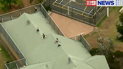 Authorities are trying to convince the inmates to come down. (9NEWS)