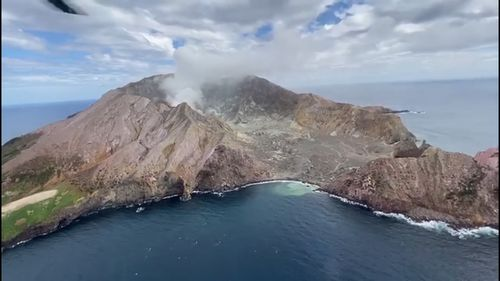 Arial video shows White Island three weeks before it erupted yesterday killing at least five people.