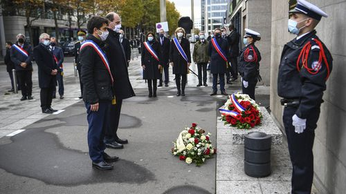 Saint-Denis Mayor Mathieu Hanotin, left, and French Prime Minister Jean Castex participate in a wreath laying ceremony, marking the 5th anniversary of the Nov. 13, 2015 attacks outside the stadium Stade de France in Saint Denis, near Paris, Friday, Nov. 13, 2020