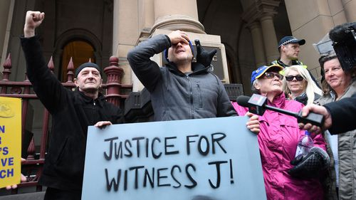 Supporters of abuse victims are seen outside the Supreme Court of Victoria as Cardinal George Pell appealed his conviction.