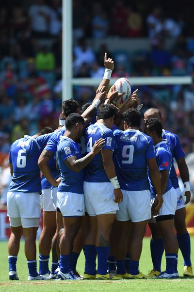 The Samoan team huddles ahead of their match with Argentina. (AAP)
