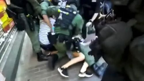 Hong Kong police have come under fire after footage of officers tackling a 12-year-old girl to the ground near a pro-democracy protest went viral.