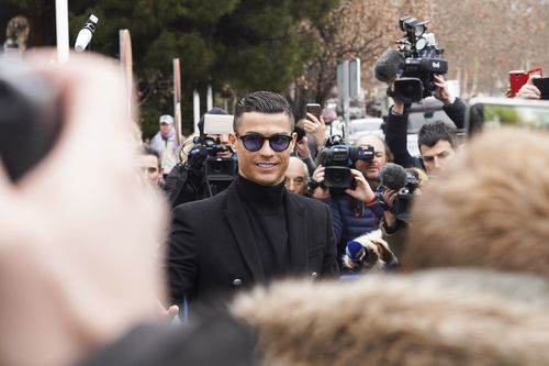 Ronaldo wore a big smile as he arrived in court in Madrid to plead guilty to tax fraud.