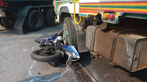 """""""The driver made an illegal turn and only stopped because his motorcycle was wedged under the wheel so it couldn't move,"""" Mr Bailey said. (Supplied)"""
