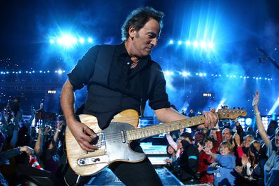 Musician Bruce Springsteen and the E Street Band perform at the Bridgestone halftime show during Super Bowl XLIII.