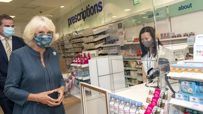 Camilla, Duchess of Cornwall wears a face mask during a visit to Boots Piccadilly Store to hear about their support of the charity Hestia's Safe Spaces programme for victims of domestic violence as well as to learn about the company's response to the coronavirus crisis on July 28, 2020 in London, England