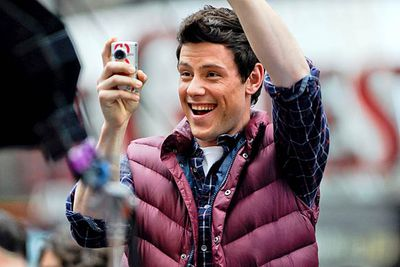 Cory Monteith takes photos and waves to <i>Glee</i> fans.