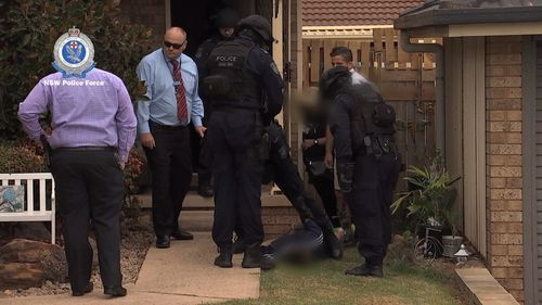 A 37-year-old man was arrested at the home and taken to Campbelltown Police Station.
