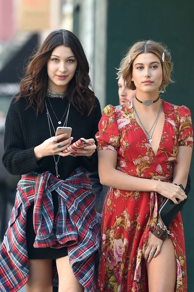 BFFs Hailey Baldwin and Bella Hadid hold hands as they walk together after doing a photo shoot on April 2, 2015 in New York.