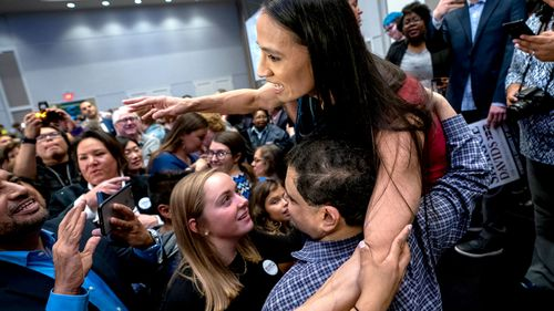 Democratic House candidate from Kansas Sharice Davids celebrates as she becomes the first lesbian Native American Congresswoman by beating Republican incumbent Kevin Yoder.