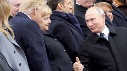 Russian President Vladimir Putin gives US President Donald Trump a thumbs up as he arrives at a ceremony in Paris marking 100 years since the end of WWI.