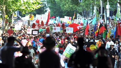 Thousands of people swarmed to Syndey's CBD today for the People's Climate March in a public show of support for the environment which took place across the globe today. (AAP)