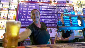 A bartender pours a drink at Six Tanks Brewery on Mitchell St in Darwin on May 15