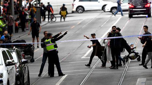 Police shut down Bourke Street.