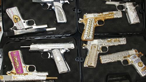 Gold-plated, diamond-encrusted weapons are shown to the press after they were confiscated when the army seized a ranch in Zapopan, Mexico in 2010. According to prosecutors, the weapons are believed to belong to the Valencia gang, allies of the powerful Sinaloa drug cartel