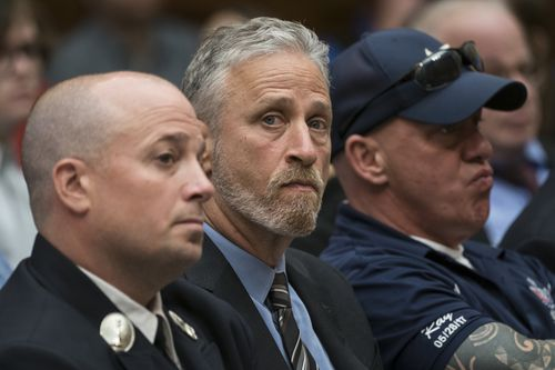 Entertainer and activist Jon Stewart, centre, lends his support to firefighters, first responders and survivors of the September 11 terror attacks at a hearing by the House Judiciary Committee on Capitol Hill in Washington.