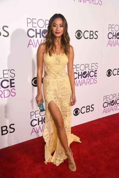 <p>Jamie Chung flashed some skin in this sweet lace full-length dress by Martha Medeiros.</p> <p>Image: Getty.</p>