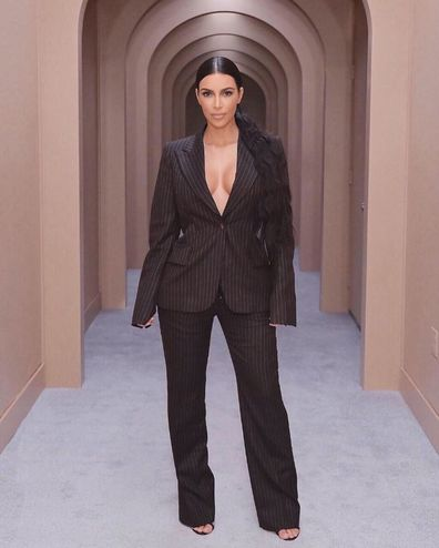 Kim Kardashian in a suit, studying law