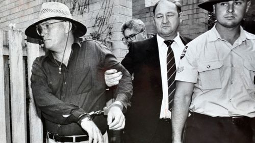 David Harold Eastman is arrested and handcuffed and is led to a police vehicle, outside his flat in Reid in 1992