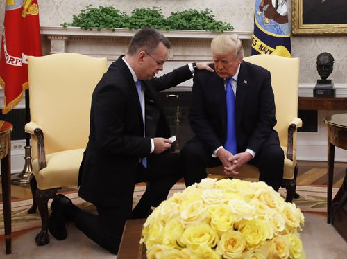Trump prays with American pastor Andrew Brunson in the Oval Office on Saturday.