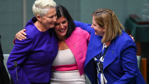 Kerryn Phelps, Julia Banks and Rebekha Sharkie react after the passing of the Medivac Bill.