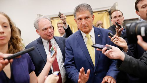 The remaining undecided Democrat, Senator Joe Manchin, said minutes after he will also support Mr Kavanaugh.