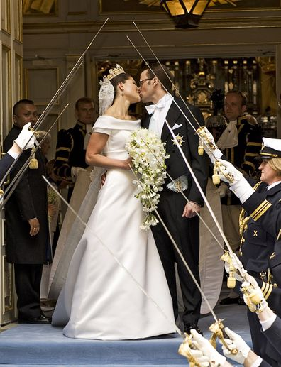 Crown Princess Victoria of Sweden and her husband Prince Daniel of Sweden kiss as they leave Storkyrkan Church.