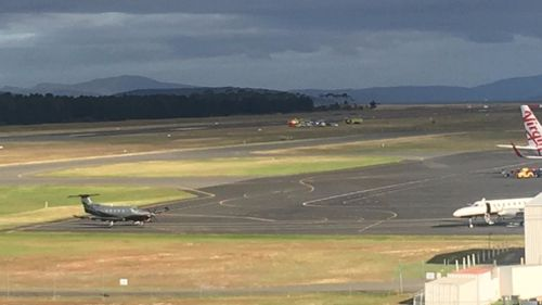 Debris can be seen on the runway at Hobart Airport. (Twitter via Georgia Westgarth)