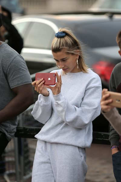 Fiancee Hailey Baldwin watched on, filming the romantic performance from the crowd.