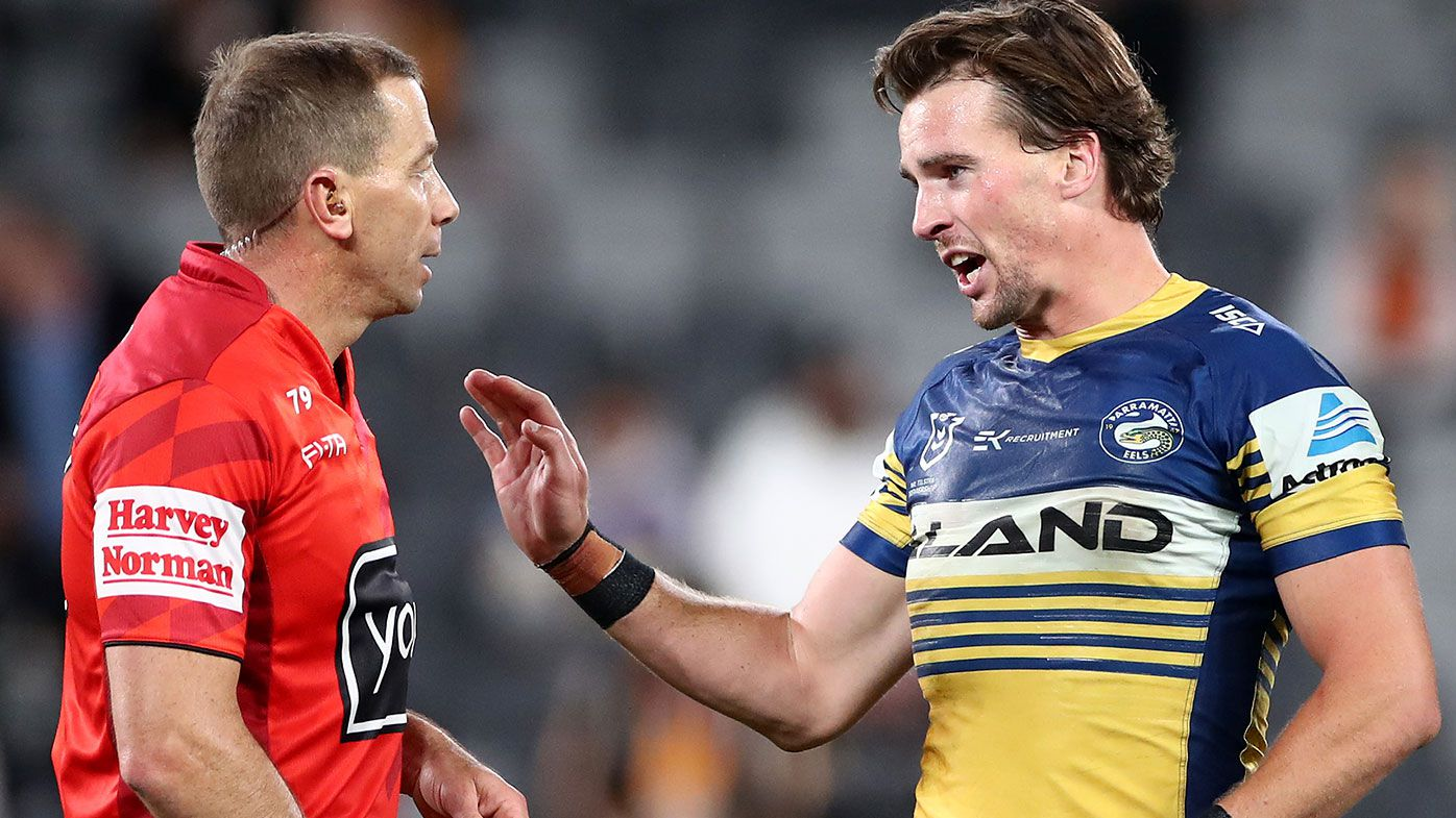 Clint Gutherson of the Eels talks to referee Ben Cummins