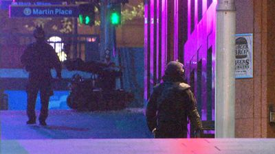 A bomb disposal robot enters the cafe. (9NEWS)