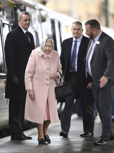 Britain's Queen Elizabeth arrives at King's Lynn railway station in Norfolk, after travelling from London at the start of her traditional Christmas break, which will be spent on the Royal estate at Sandringham