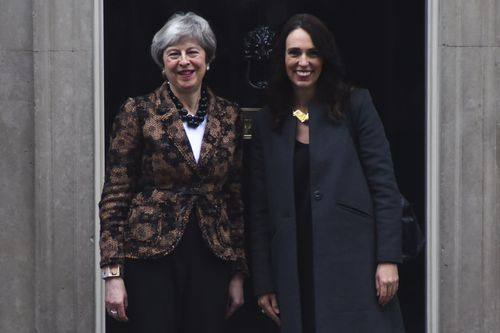 British Prime Minister Theresa May (left) greets New Zealand's Prime Minister Jacinda Ardern outside 10 Downing Street in central London.