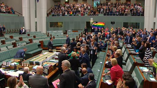 MPs hugged and the public gallery broke out into song as the result of the vote was announced.