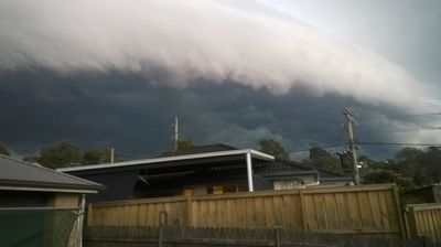 The storm front rushing over Cam Harper's house in Allambie on Monday.