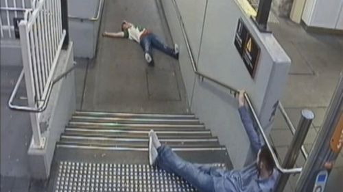 CCTV from the night shows them laying on the stairs at the train station.