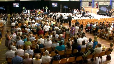 <p>Mourners pack the sports hall at Macksville High.</p><p>Phillip Hughes is being farewelled today in Macksville, his hometown.</p>  <p>More than 5000 mourners from around the world have arrived in the NSW north coast town to say goodbye to the batsman, who died last week after being struck in the head during a Sheffield Shield game.</p>  <p><strong>Click through to see photos from today's memorial.</strong></p>