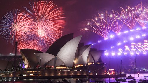 Fireworks explode over the Sydney Harbour Bridge and the Sydney Opera House in the midnight display during New Year's Eve celebrations on January 1, 2020 in Sydney, Australia.