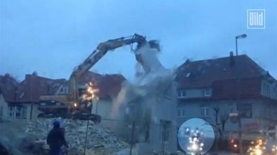 "<p>Video has emerged of a German cyclist narrowly avoiding a crushing death by falling debris from a botched demolition.</p><p>  An excavator was hard at work in the independent city of Oldenburg, in the state of Lower Saxony, last week when the unidentified woman pedalled past the demolition site. </p><p>  The footage shows the wall suddenly collapse, sending huge chunks of rock and dust crashing to the ground, just missing her. </p><p>  Construction worker Hakki Biliz told German newspaper Bild the only thing harmed in the end was the fence surrounding the demolition zone. </p><p>  ""(It caused) 45 euros worth of damage. My boss is going to buy a new one,"" he said. </p><p>  Check out this gallery for more demolitions gone wrong.</p>"