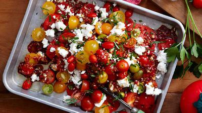 "Click through for our <a href=""http://kitchen.nine.com.au/2016/05/16/13/11/mixed-tomato-salad-with-pomegranate-dressing"" target=""_top"">mixed tomato salad with pomegranate dressing</a> recipe"