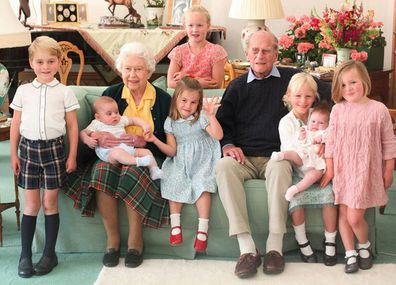 The Queen and Prince Philip surrounded by seven of their great-grandchildren at Balmoral Castle in 2018 (L-R front: Prince George, Queen with Prince Louis, Princess Charlotte, Prince Philip, Isla Phillips, Lena Tindall, Mia Tindall. Back: Savannah Phillips)