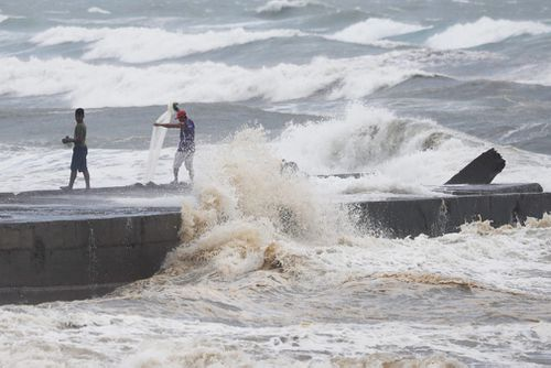Typhoon Mangkhut slammed into the country's north-eastern coast early this morning, with witnesses saying the storm's ferocious wind and blinding rain ripped off tin roof sheets and knocked out power at the start of the onslaught.