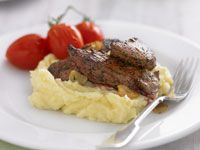 Kangaroo steaks with roasted tomatoes